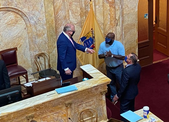 Senate President Stephen Sweeney, D-Gloucester, Sen. Troy Singleton, D-Burlington, and Sen. Paul Sarlo, D-Bergen, speak during a break in a Senate voting session on June 29, 2020.