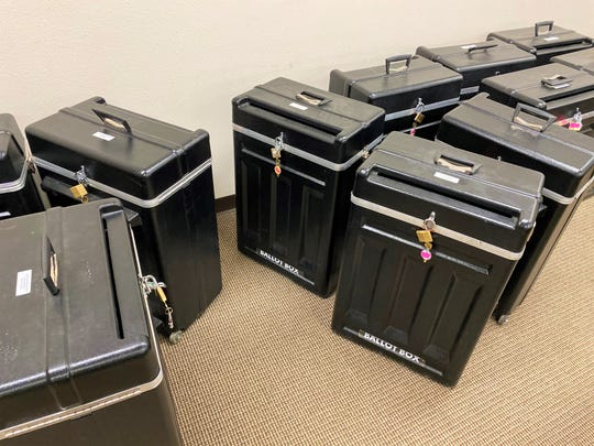 Official ballot boxed remained locked until it was time to run each ballot through the machines during the recount om June 29.