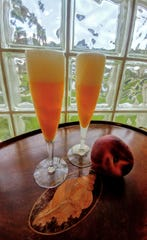 Frothy cold Peach Bellinis are perfect for Florida summers.