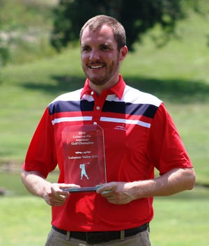 Justin Arnt proudly shows off his 2020 Lebanon County Amateur trophy.