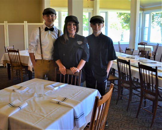 Chef Stacy Maple stands with her sons, Christian Maple, left, and Noelton Maple, in the Hotel Lakeside Dining Room.  Maple is the new Director of Culinary Services and Wellness Programming at Lakeside.