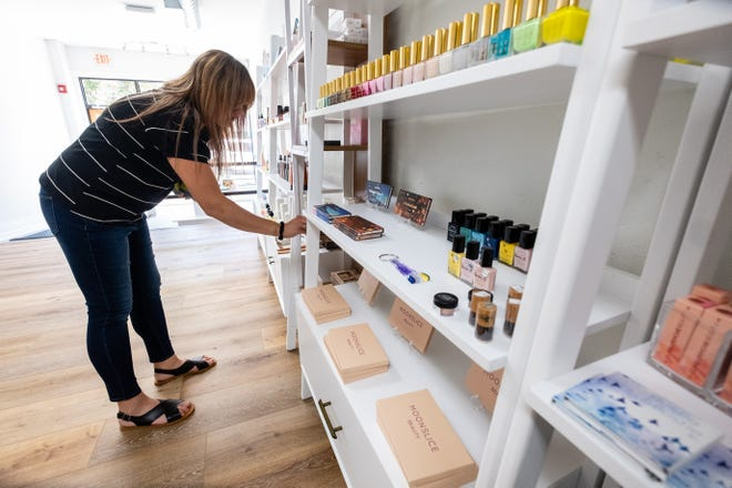 Sindy Marion stocks shelves in batchmade BEAUTY Monday, June 29, 2020, in downtown Port Huron. Marion, who co-owns MIgardener, is opening the store.