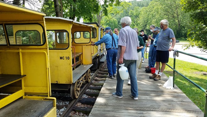 Volunteers clean the train at the Ma & Pa Railroad Heritage Village of Muddy Creek Forks. The village is open for guided tours on Sundays.