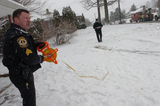 In this file photo from March 7, 2007, then-York Area Regional Police Sgt. John Fishel investigates the scene of a fatal accident on East Prospect Road in Windsor Township.