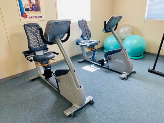 Donated exercise equipment from the Lakeridge Tennis Club fitness center is seen at The Village on Sage Street.