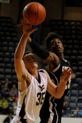 Water Valley High School's Brock Demere and Crowell's Will Hogan battle for a rebound during a Claass 1A Division II regional semifinal playoff game in Abilene on March 1, 2013.
