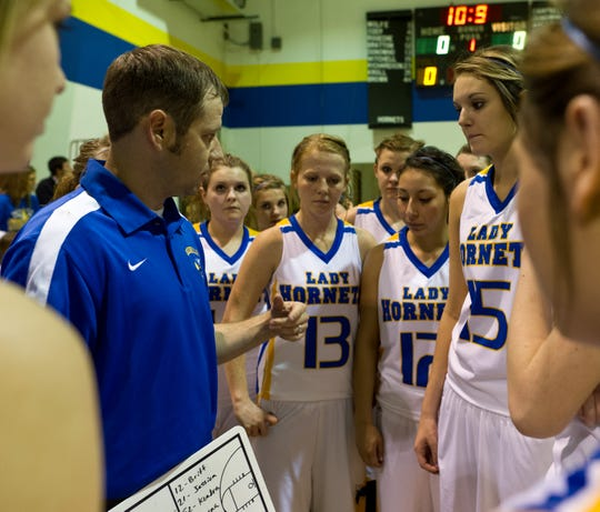 Rochelle head coach Jym Dennis, left, and the Lady Hornets reviewed the opening game plan before their district-title game against Cherokee in 2012.