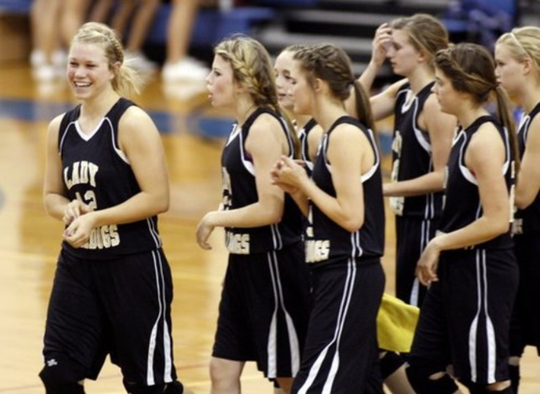 Members of the Brady High School Girls Basketball Team celebrate after a 2010 win over San Angelo Lake View.