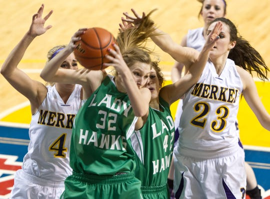 Wall's Hannah Holik takes a rebound away from Merkel's Chera Chaney, left, and Allison Szabo, right, in a regional quarterfinal playoff game in 2012. Wall upset No. 1 Merkel 34-30.