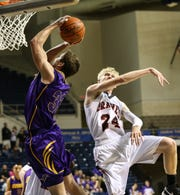 Ozona High School's Jerrrod duBois eludes the shot block attempt by Iraan's Zane Graham during their first-round playoff game in 2013.