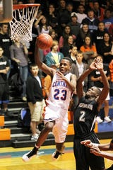 Central High School's Reggie Sutton makes a move to the basket around Odessa Permian's Jorrion Wilson during Friday night's District 3-5A game in San Angelo on Jan. 7, 2011.