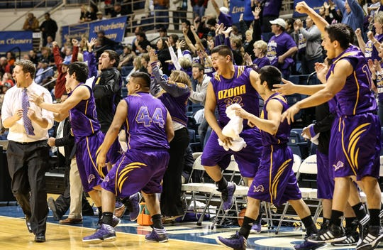 The Ozona Lions' bench and coach Ethan Lunn, left, went wild as Tyler Galindo sank the second of two free throws to put the Lions ahead of the Iraan Braves 41-39 with three seconds left in their first-round playoff game in 2013.