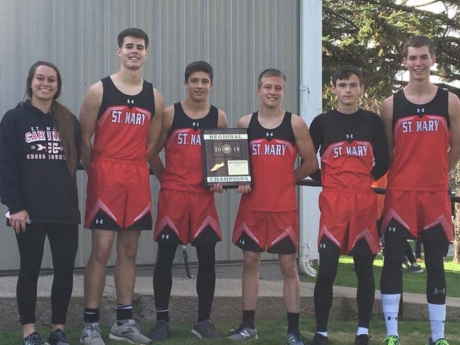 Dell Rapids St. Mary won the boys Region 2B cross country title in 2019. Team members include (l-r): Coach Alyssa Brazil, Ryan Eining, Connor Libis, Jacob Vogel, Seth Roemen, Thomas Eining. Not pictured: Noah Reiff.