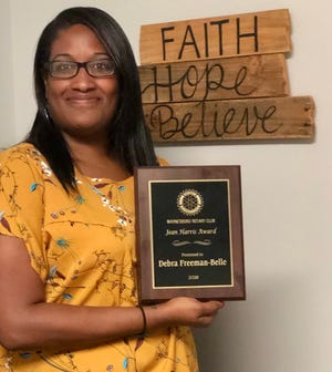 The Jean Harris Award for outstanding service by a non-Rotarian woman went to Debra Freeman-Belle, Director of the Waynesboro Area Refuge Ministry, for her work with the homeless.
