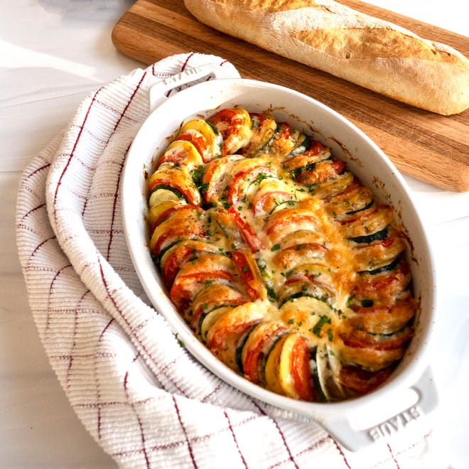 Make Ahead Veggie Tian layers potatoes, zucchini and tomatoes on a bed of onions.