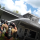 Merrill firefighters extinguish a house fire Sunday afternoon on North Mill Street.