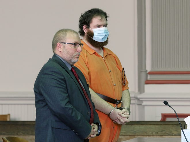 Joshua Kearns, right, seen with his defense attorney Keith Edwards, was sentenced to life in prison with a chance of parole after 32 years after pleading guilty to several sex related charges.