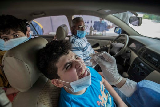 Egyptians get tested for COVID-19 at a drive-through coronavirus-testing center at the Ain Shams University in Cairo on June 29, 2020. Egypt has so far registered 65,188 COVID-19 cases including 2,789 fatalities.