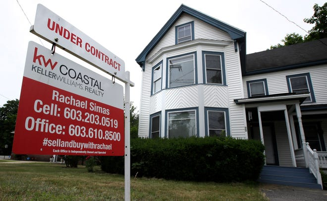 "In this June 20, 2018, file photo, an ""Under Contract"" sign is displayed in front of home for sale in Raymond, N.H."
