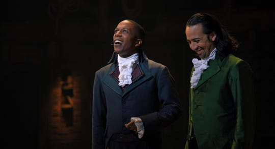 "Aaron Burr (Leslie Odom Jr., left) and Alexander Hamilton (Lin-Manuel Miranda) are friends and rivals in ""Hamilton."""
