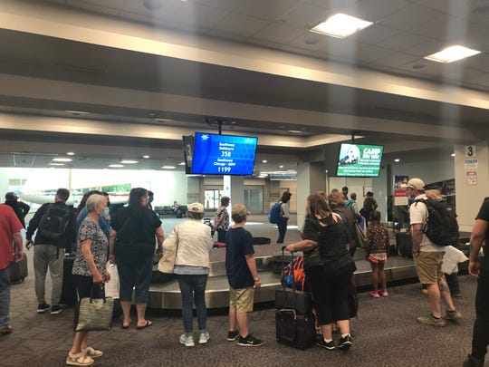 The Southwest Airlines baggage claim carousel at TF Green International Airport in Providence, Rhode Island, was crowded on a summer Saturday despite social distancing recommendations during the coronavirus pandemic.