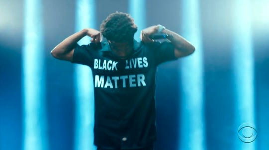 Roddy Ricch wears a Black Lives Matter shirt while performing during the BET Awards.