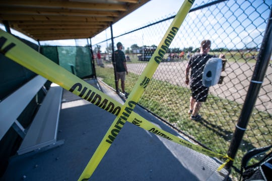 A dugout is closed for a game involving teams from the Greenfield Youth Baseball Association League in Indianapolis.