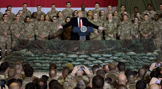 President Donald Trump speaks to the troops during a surprise Thanksgiving day visit at Bagram Air Field in Afghanistan, Nov. 28, 2019.