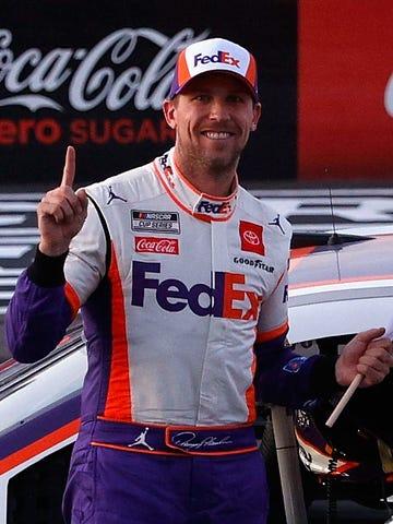 Denny Hamlin celebrates after winning the Pocono 350, Sunday at Pocono Raceway.