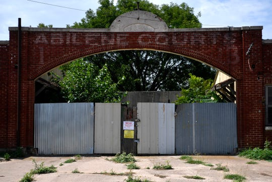 The gate of Abilene Courts at 627 S.11th Street on Tuesday. The Abilene Preservation League is hoping to restore the property, which is a 90-year-old precursor of the modern motel.