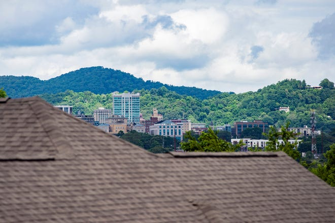 A view of downtown Asheville is seen from the under-construction White Oak Grove Apartments on Hazel Mill Road on June 23, 2020.