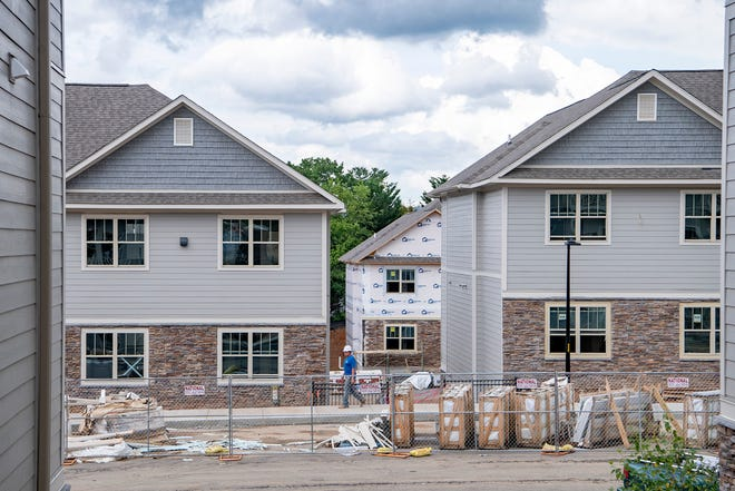 Unemployment dropped under 10% in Buncombe County and the Asheville metro area in June after setting records in double digits in April and May. Here a crew works on a set of buildings at the under-construction White Oak Grove Apartments on Hazel Mill Road on June 23, 2020. The completed project will have 10 buildings with 110 units, most with two bedrooms and two bathrooms.