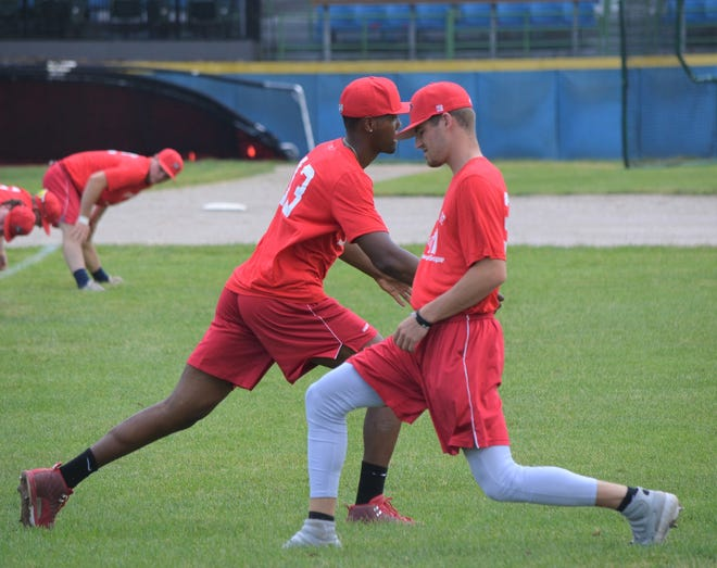 Battle Creek Bombers spread out on the field, or do staggered stretching drills in opposite directions, during warmups,  allowing for social distancing as the Northwoods League gets ready to start the season this week.
