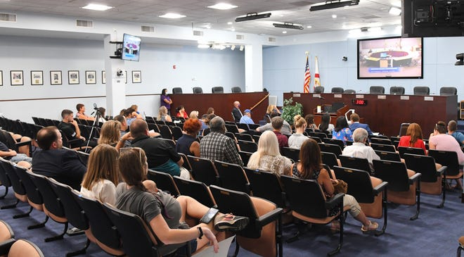 The dais in the Commission Room at the Brevard County Government Center in Viera was empty during Tuesday's County Commission meeting, with commissioners in a separate meeting room on the third floor, as a way to help maintain social distancing.