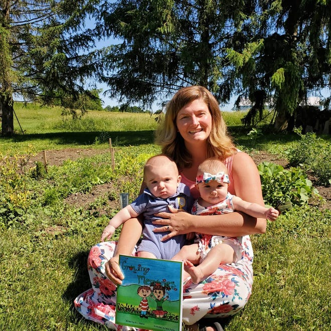 """Roxanne Sams,  a former teacher at Allen Elementary, has published her fourth book """"Growing Memories"""". The story is kind of like a how to gardening book that stars Sams' five month old twins as toddlers learning about the joys of gardening and the memories that come with it."""