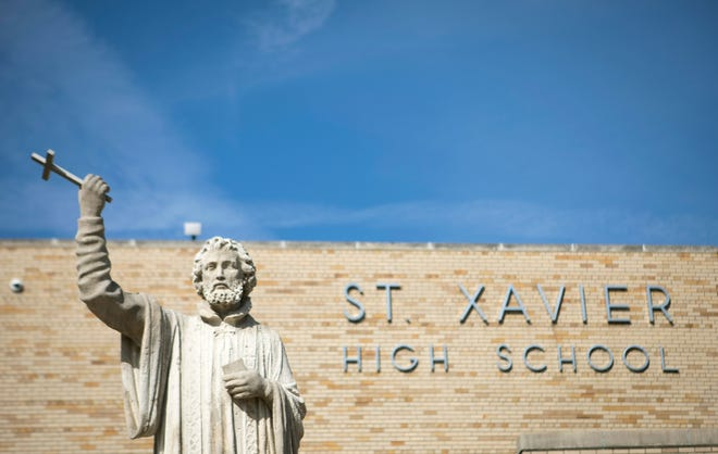 St. Xavier High School principal Terry Tyrrell notified student's parents Monday that a member of the football team has tested positive for COVID-19.