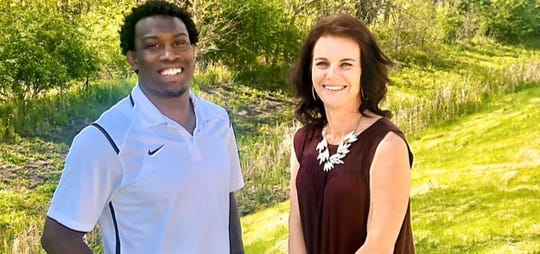 Iowa State wrestling great Kyven Gadson, left, and Erica Andorf, right, the mother of Iowa State wrestler Marcus Coleman, have created a program to serve at-risk youth.