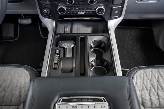 The 2021 Ford F-150 has a gear shifter that folds down and tucks into the center console with the push of a button.
