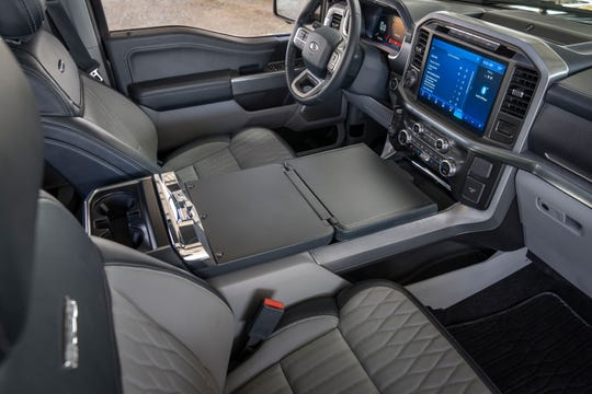 The 2021 Ford F-150 has a new interior work surface to make it easier for signing documents, using a laptop or eating lunch.
