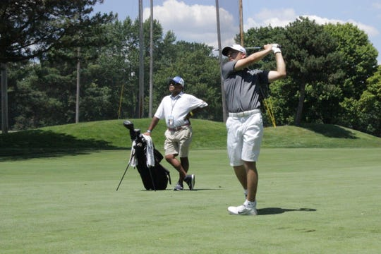 Canton's Donnie Trosper plays his approach into the second hole at Detroit Golf Club on Tuesday.