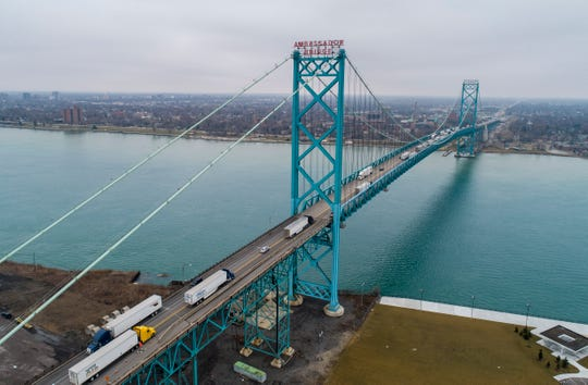 Vehicles are seen traveling from the American side of the Ambassador Bridge in Detroit to the Canadian side in Windsor, Ontario, Thursday, March 19, 2020.