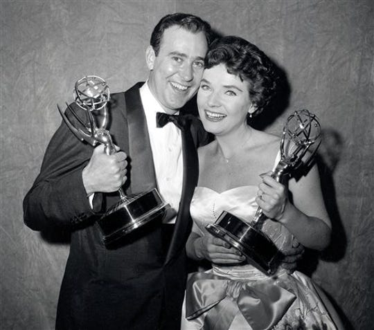 """In this April 15, 1958, file photo, writer Carl Reiner and actress Polly Bergen pose with their statuettes at the Emmy Awards presentations in New York.  Reiner won for best continuing supporting performance by an actor in a dramatic or comedy series for """"Caesar's Hour."""""""