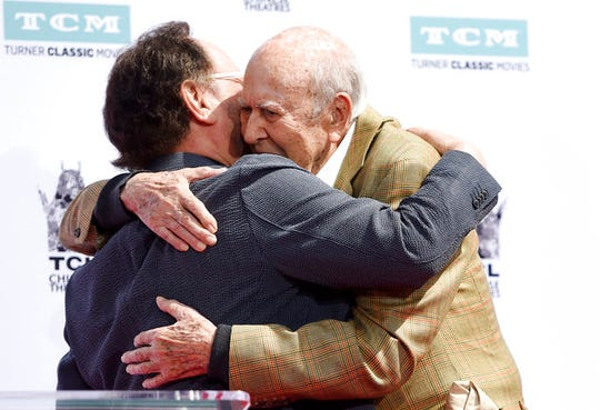 Guest speaker Billy Crystal, left, hugs Carl Reiner during a hand and footprint ceremony for the Reiners at the TCL Chinese Theatre on Friday, April 7, 2017, in Los Angeles.