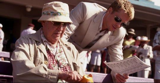 "Carl Reiner and Brad Pitt share a scene in 2001's ""Ocean's Eleven."""