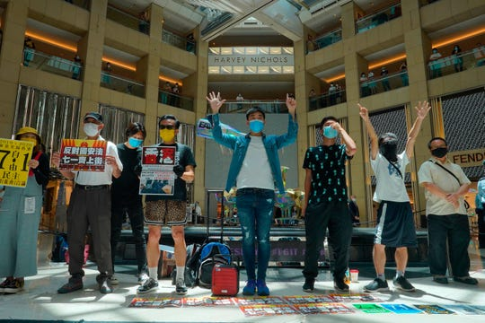 Protesters gather at a shopping mall in Central during a pro-democracy protest against Beijing's national security law in Hong Kong, Tuesday.