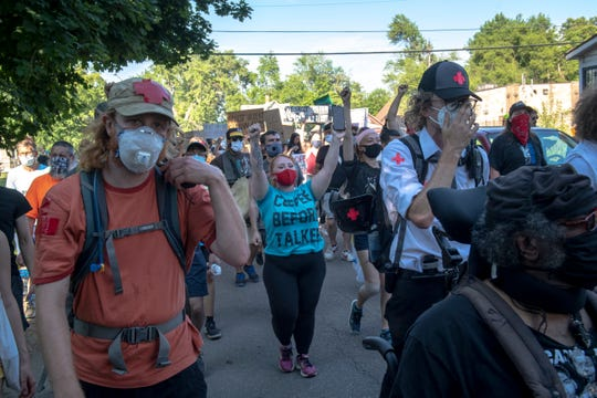 Protesters march against police brutality in Detroit on June 30, 2020.