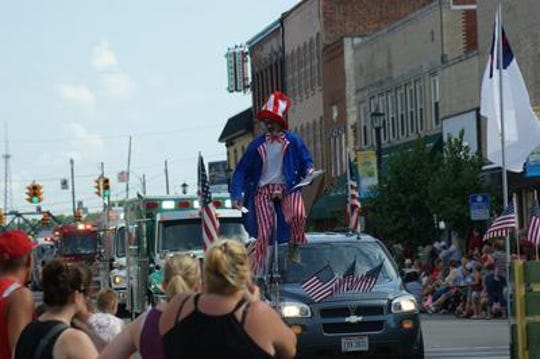 The July 4 parade in downtown Fremont in 2018 featured American flags, classic cars and a man riding a unicycle. No parade is planned for 2020 due to the COVID-19 pandemic.