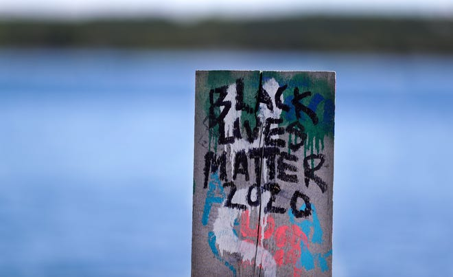 """Black Lives Matter 2020"" is painted on a post at Anderson Dock on June 12, 2020, in Ephraim, Wis."