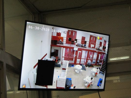 Security camera screens at the Cascade County Detention Center show inmate conditions at the overcrowded facility.
