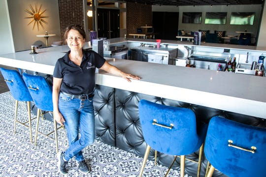 Bohemian Hotel owner Angela Harrington poses for a photo at the bar while giving a tour of the renovated hotel, Tuesday, June 30, 2020, at the Bohemian Hotel in Iowa City, Iowa.